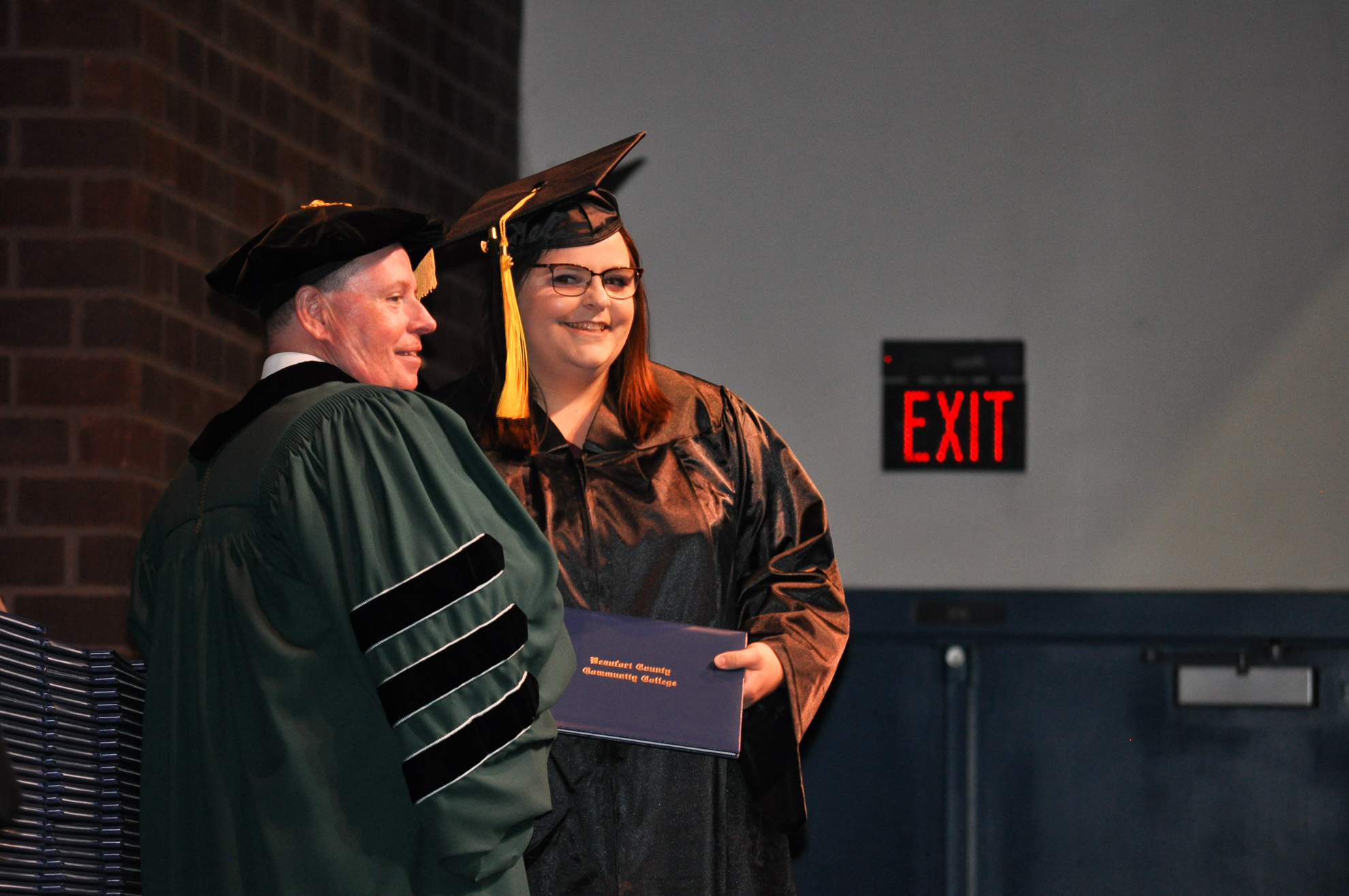A person receives a diploma at graduation.
