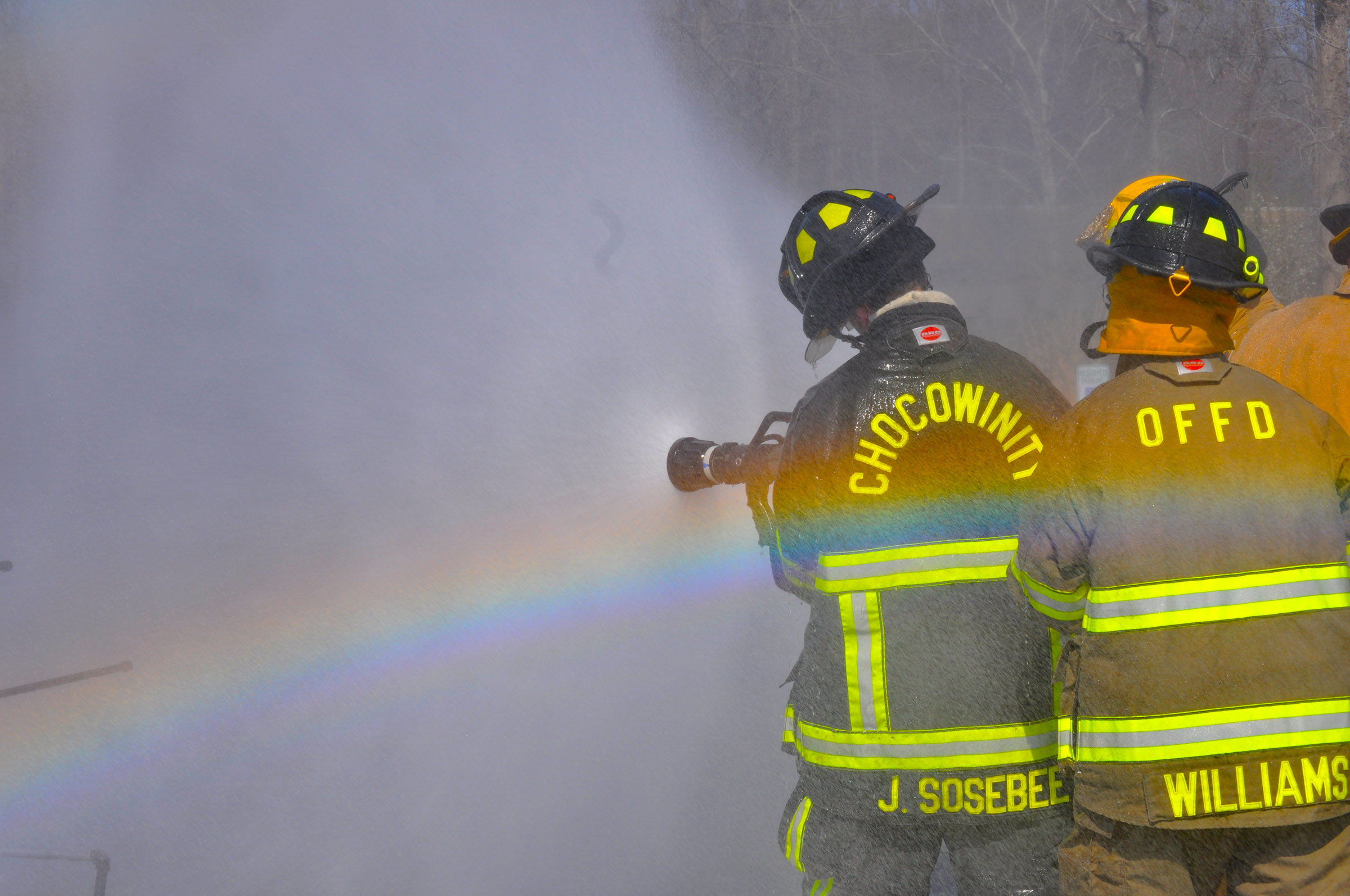firefighters with a rainbow