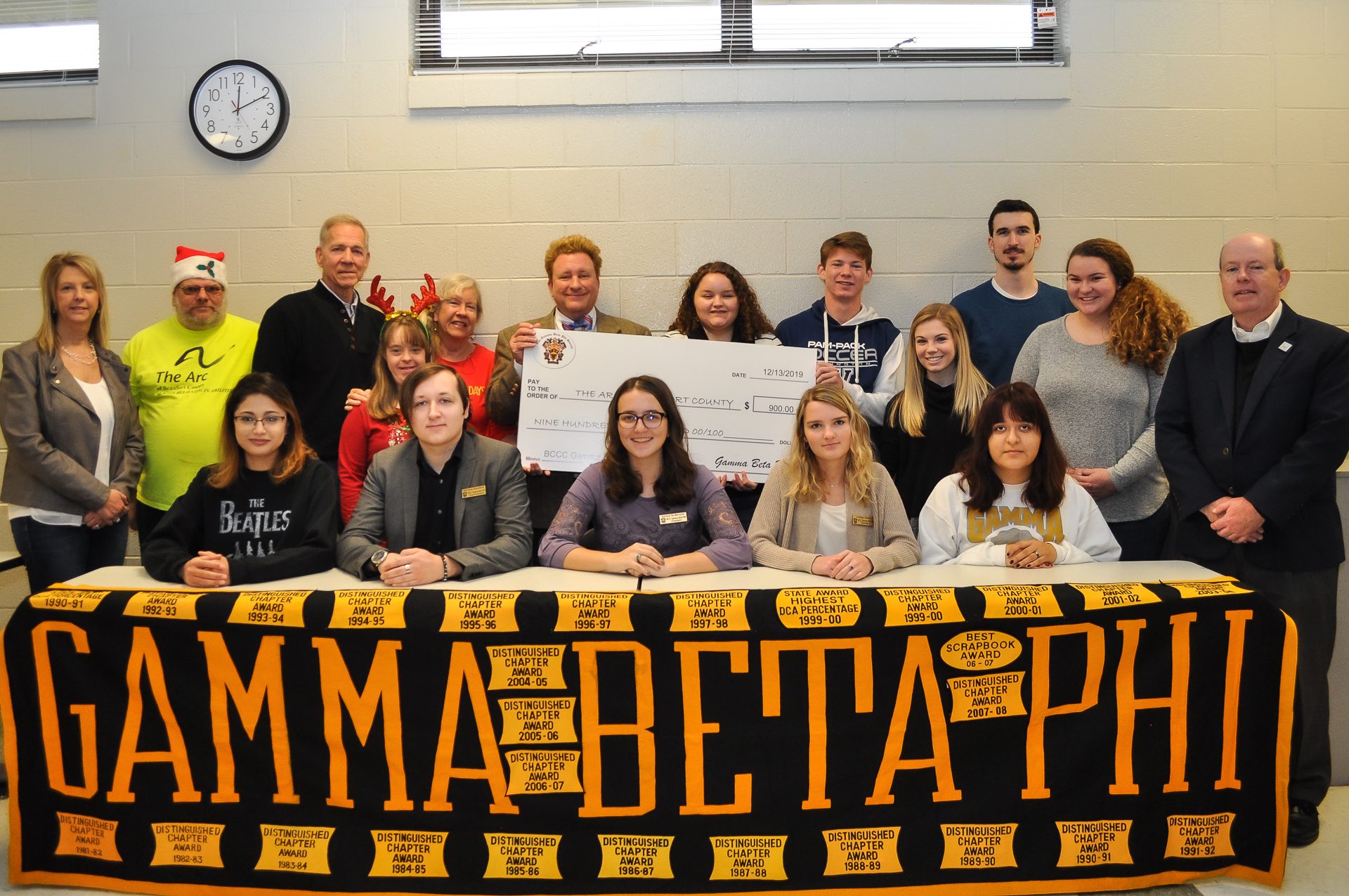 a group of people with a banner reading Gamma Beta Phi