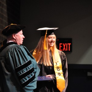 a person  getting a diploma