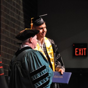 a person receiving a diploma