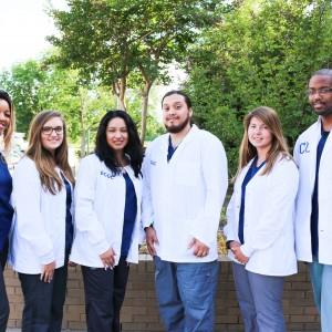 A group of students in white coats.